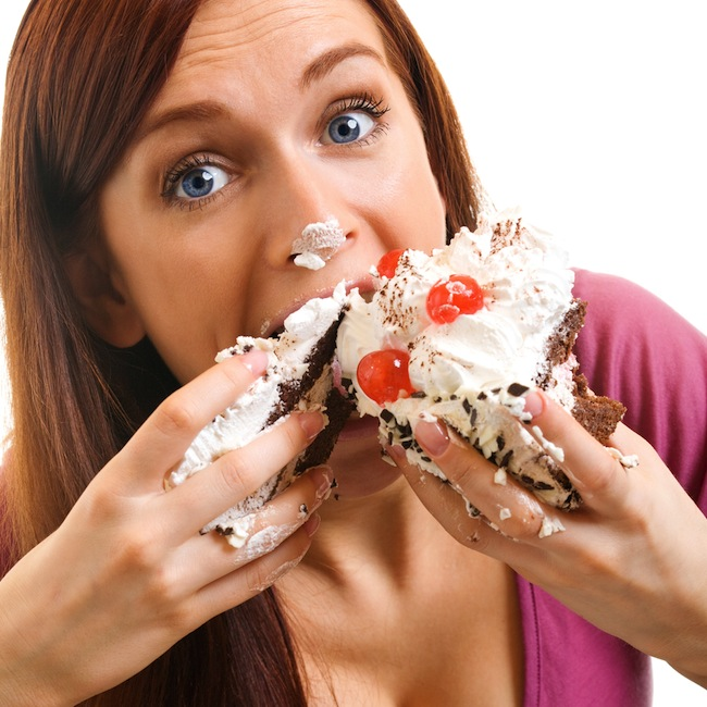 woman overeating cake